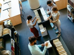Students spending time for research in university library