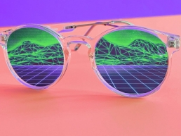Cool sunglasses with reflection of computer generated mountains and meadow